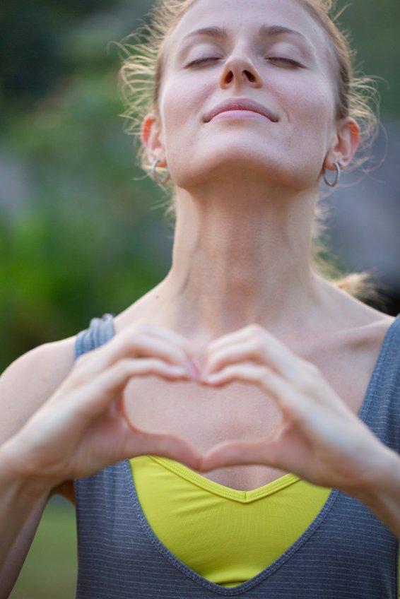 Woman making heart shape